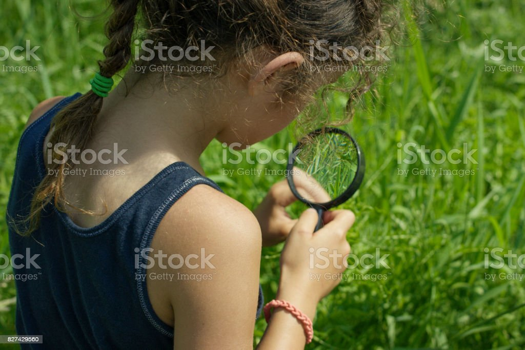 A young girl of mixed ethnicity is on a field trip with her science...