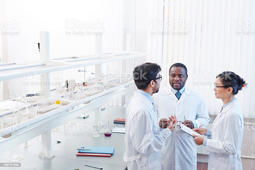 Scientific Discussion in Laboratory stock photo