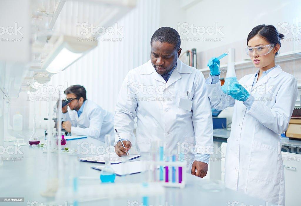 Scientific Experiment in Lab stock photo