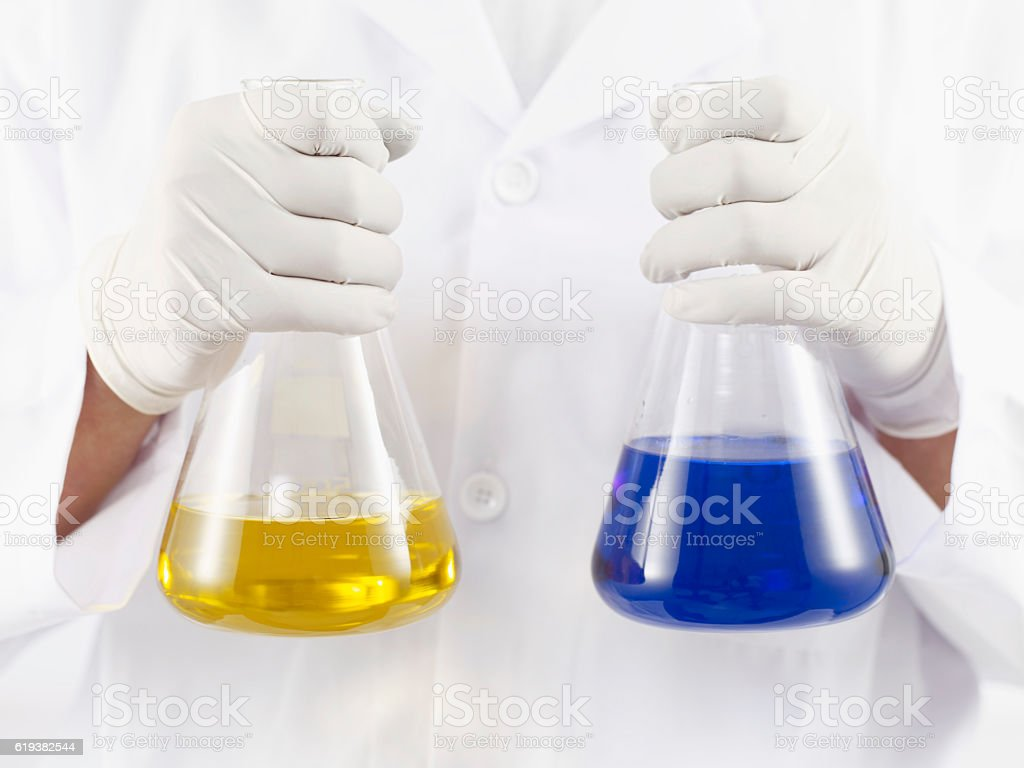 Scientific holding test tubes stock photo