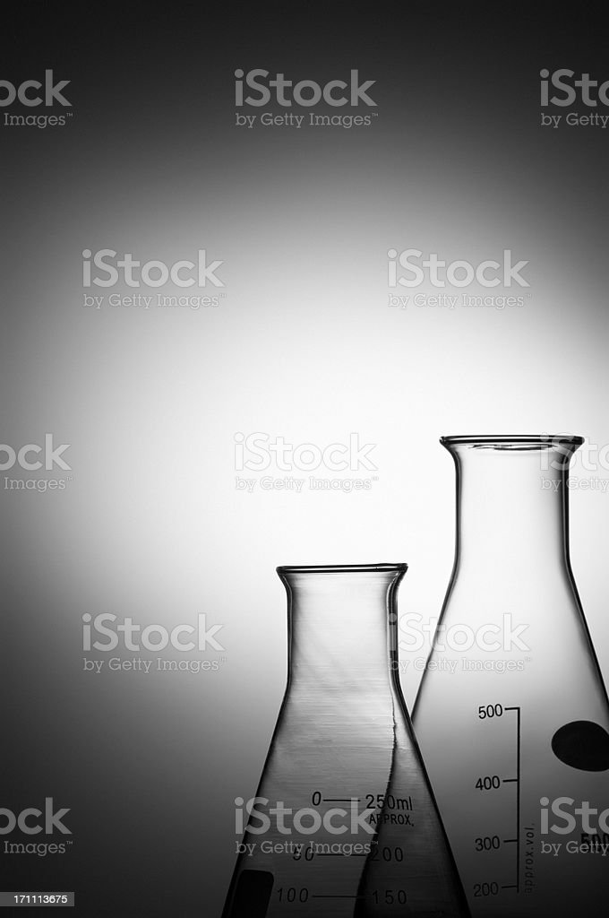 Scientific laboratory flasks in silhouette with copy space royalty-free stock photo