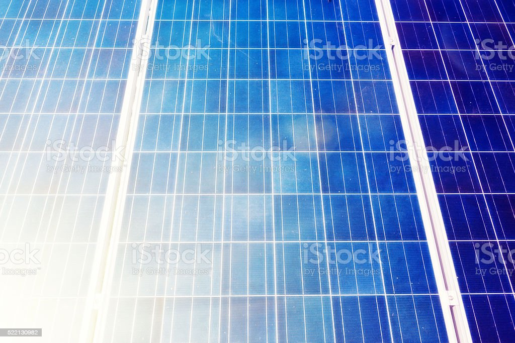 Scientific or ecological background of sunlit solar panels stock photo