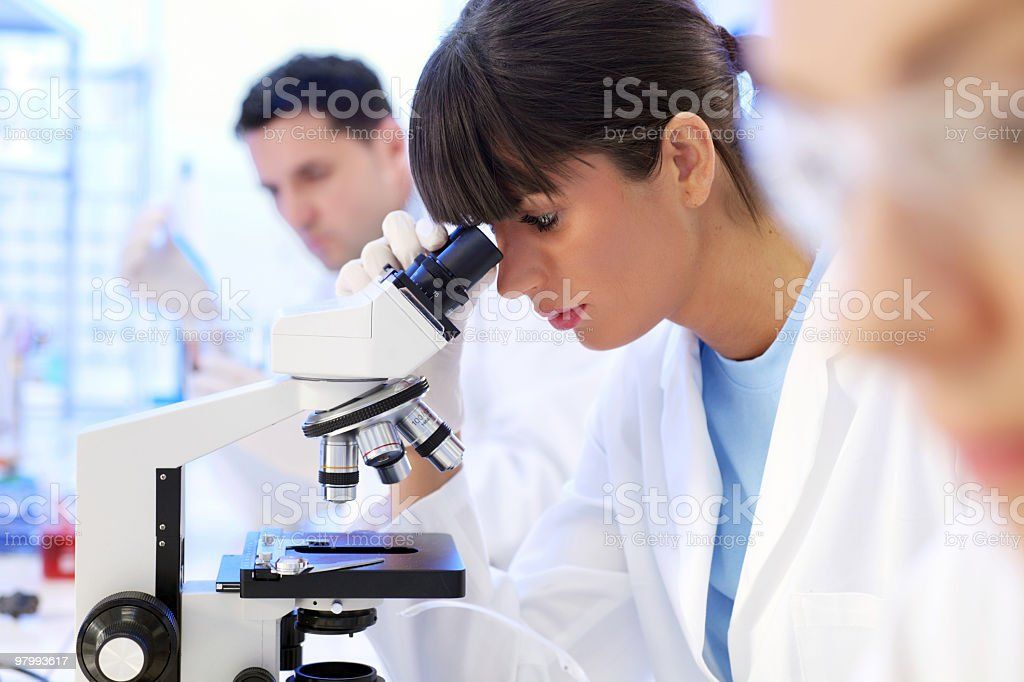Scientific researcher using a microscope. royalty-free stock photo