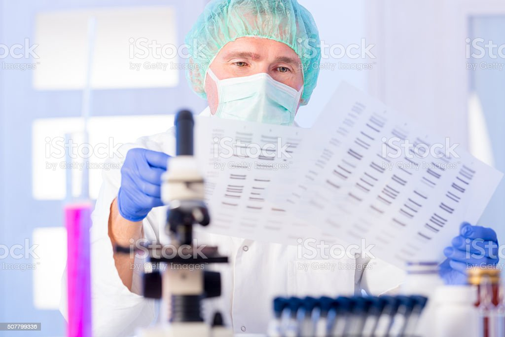 Scientist analizing DNA stock photo