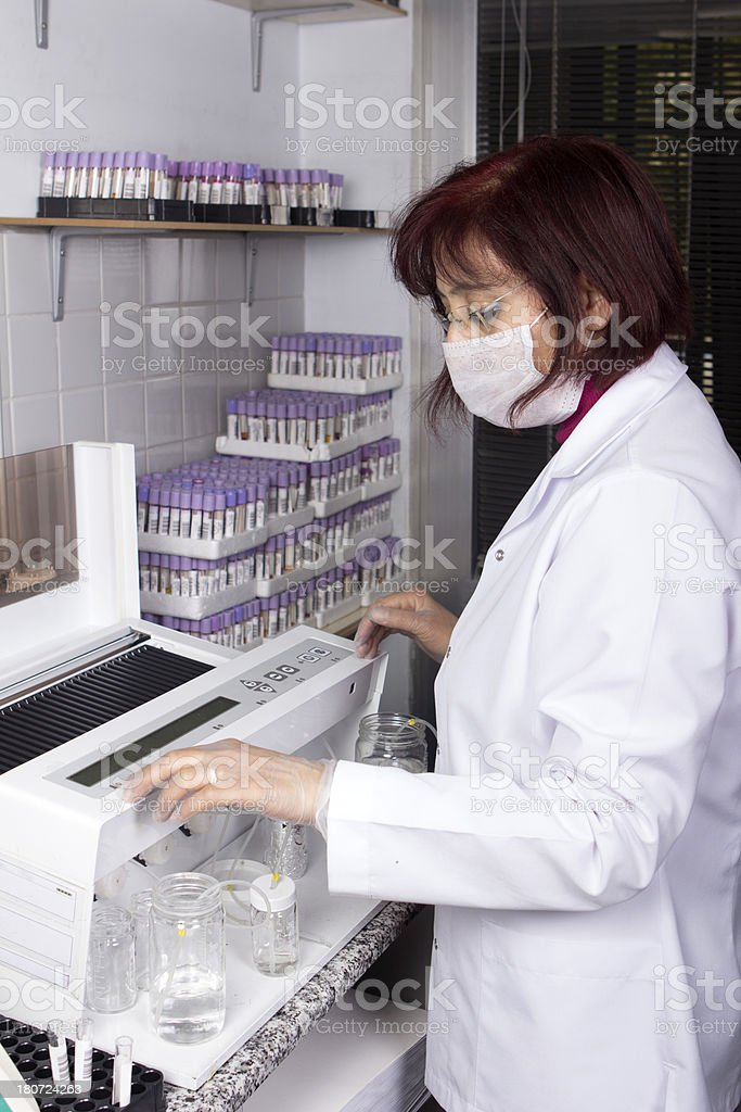 Scientist analyzing allergy test in laboratory stock photo