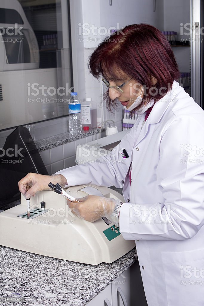 Scientist analyzing blood and urine sample in laboratory royalty-free stock photo