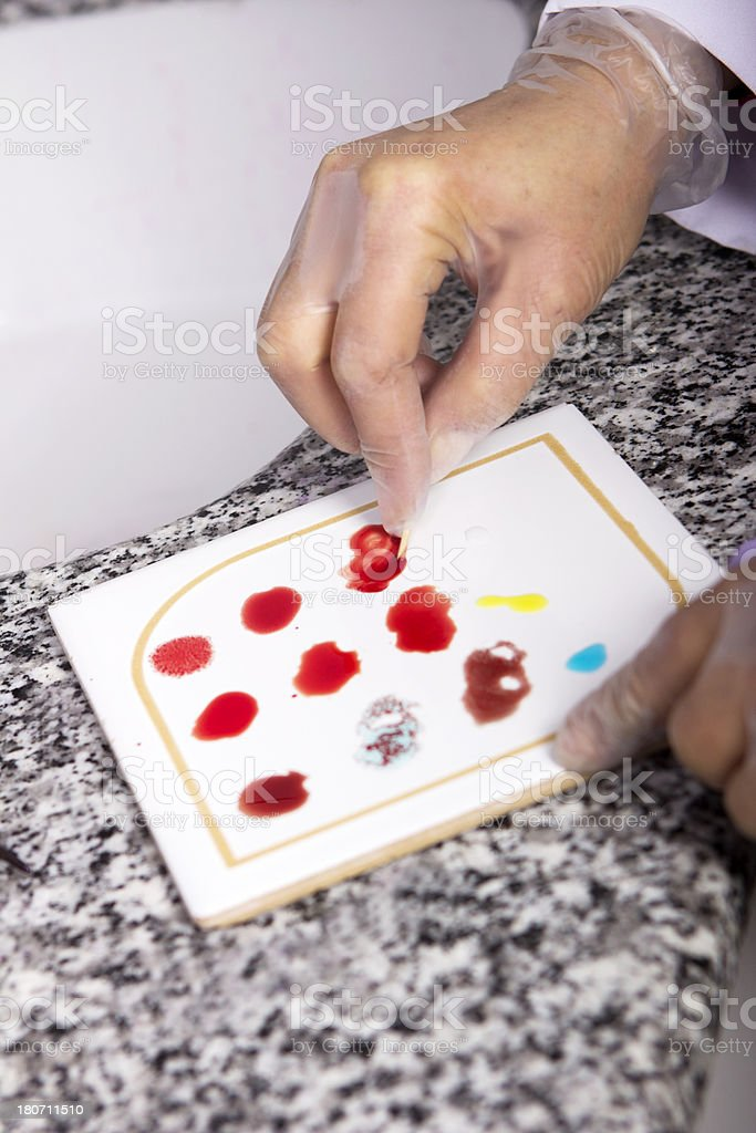 Scientist analyzing blood group in laboratory stock photo