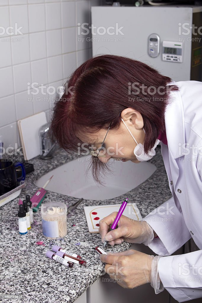 Scientist analyzing blood sample in laboratory stock photo
