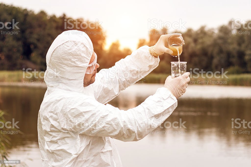 Scientist analyzing the water stock photo