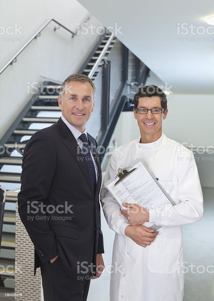 Scientist and businessman smiling in office royalty-free stock photo