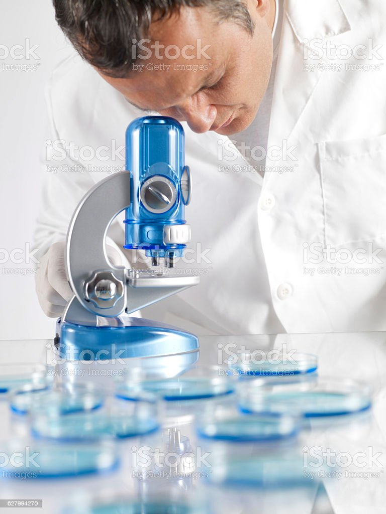 Scientist and Microscope stock photo
