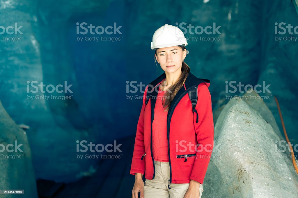 Scientist at an Expedition Site Examining a Glacier stock photo