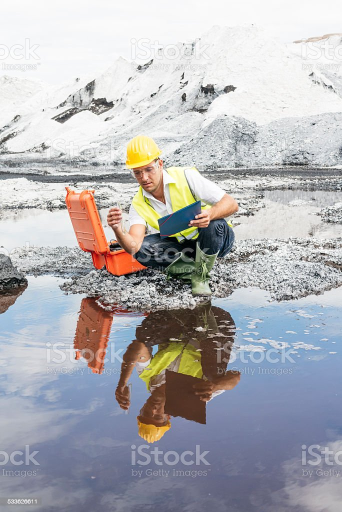 Scientist at industrial site stock photo