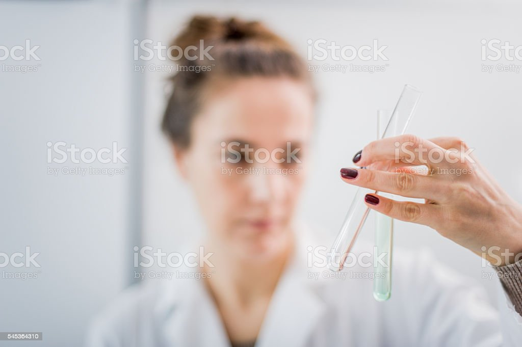 Scientist at work taking an experiment stock photo
