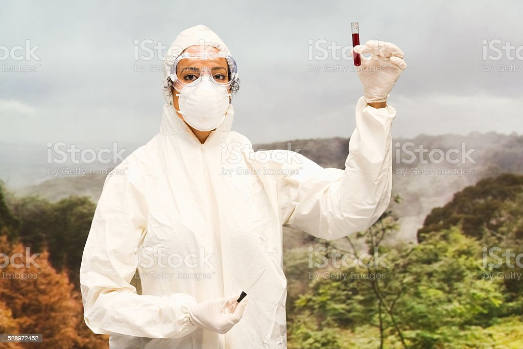 Scientist collecting blood sample stock photo