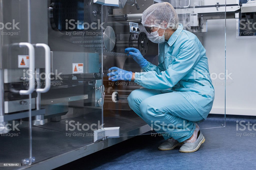 scientist conducting an audit of the company stock photo