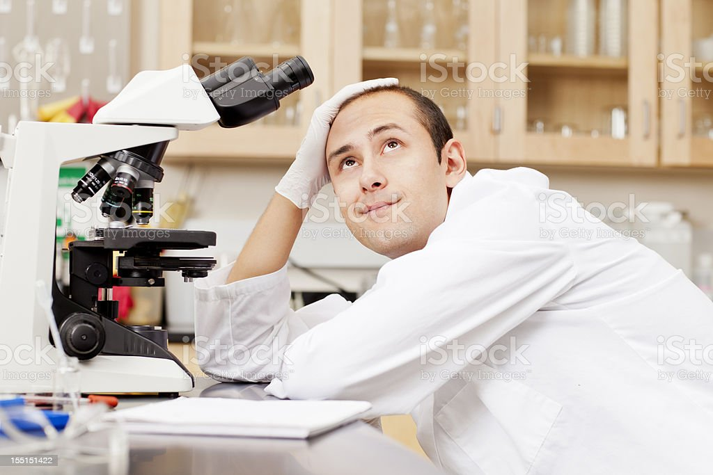 Scientist day dreaming in a lab royalty-free stock photo
