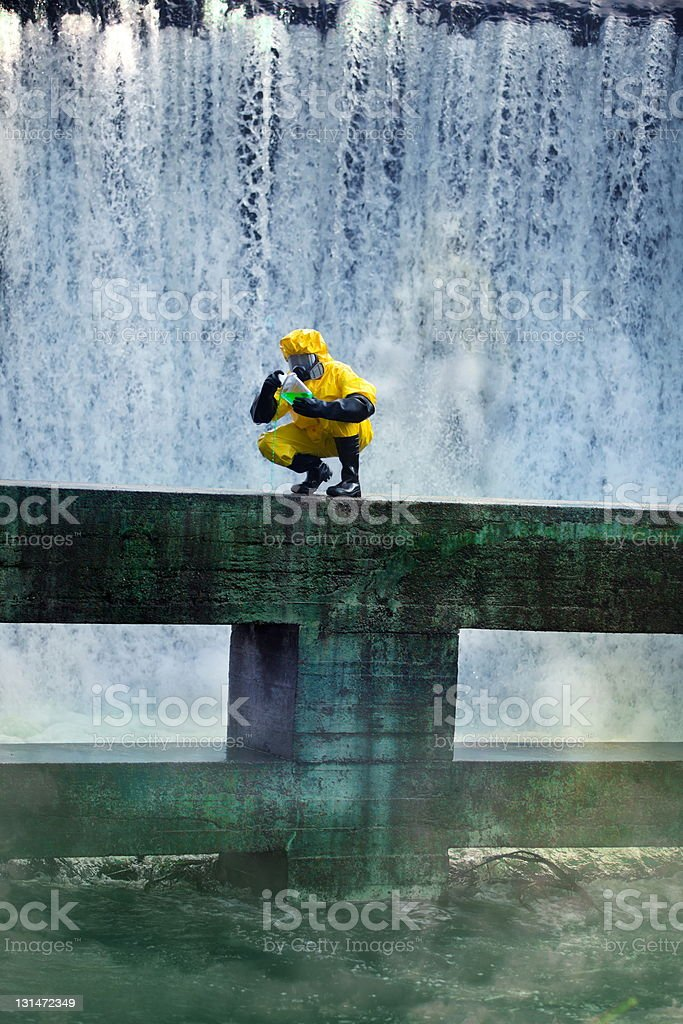 Scientist examines toxic sample from contaminated water royalty-free stock photo