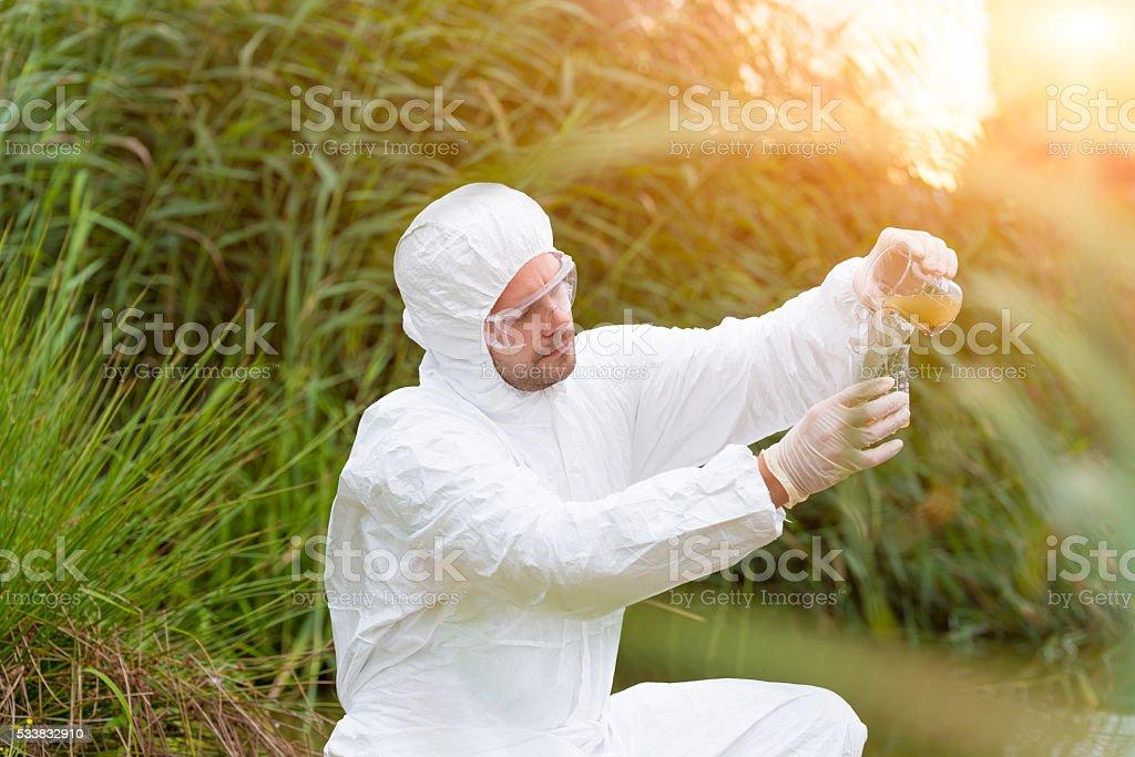 Scientist examing toxic water stock photo