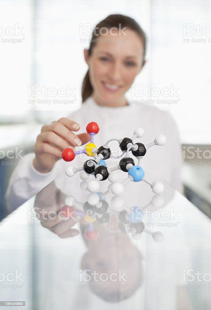 Scientist examining molecular model in lab royalty-free stock photo