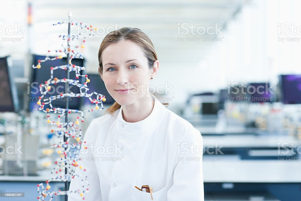 Scientist examining molecular model in lab stock photo