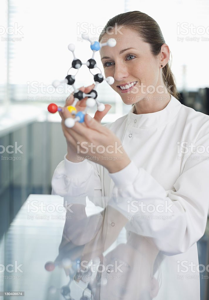 Scientist examining molecular model in laboratory royalty-free stock photo