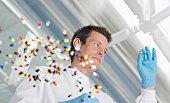 Scientist examining pills in lab