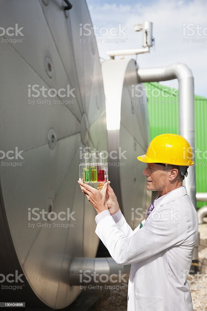 Scientist examining test tubes outdoors royalty-free stock photo