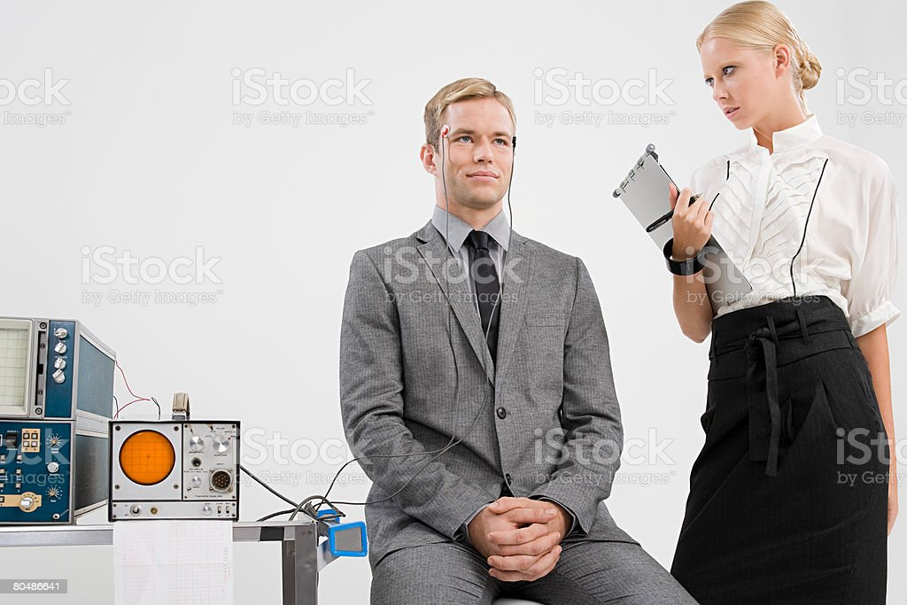 A scientist experimenting on a man stock photo