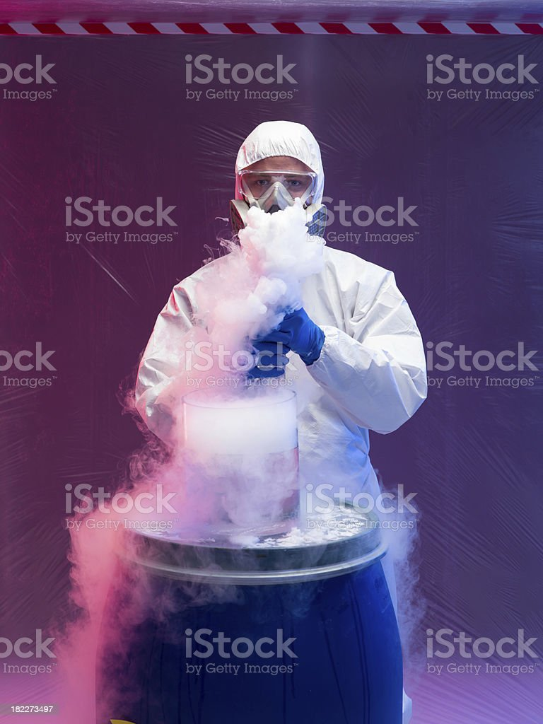 scientist experimenting with vapors on blue barrel royalty-free stock photo
