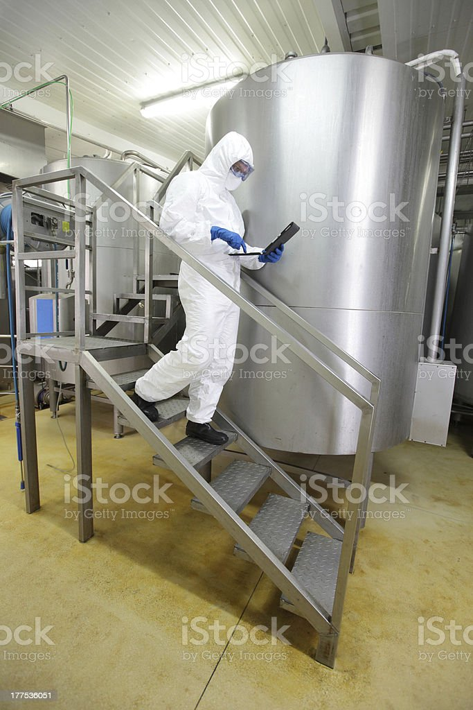 scientist focused on tablet walking down the stairs royalty-free stock photo