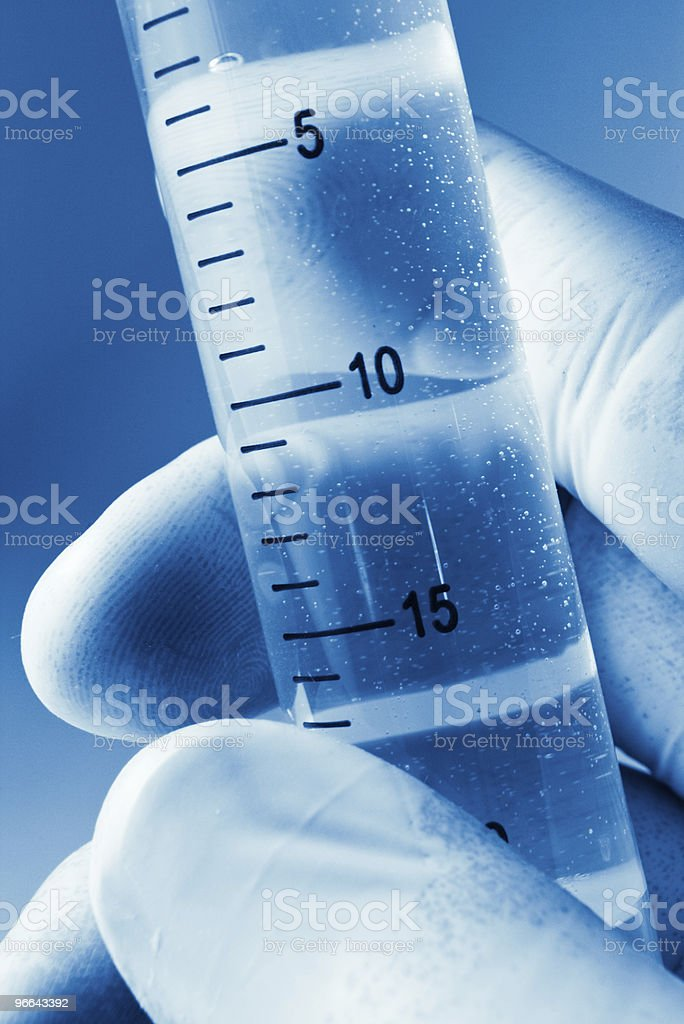 scientist hand with cylinder royalty-free stock photo