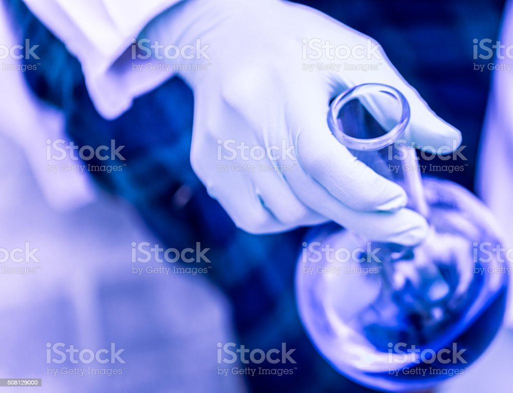 Scientist Holding a Chemical Flask stock photo