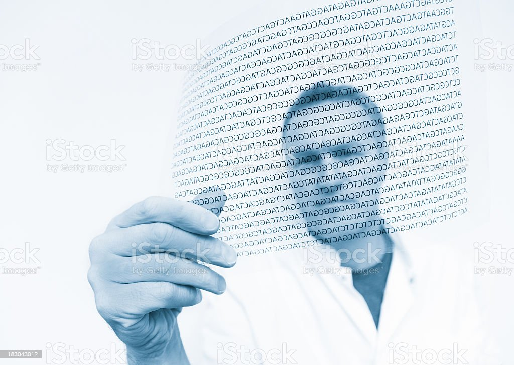 Scientist holding a digital rendition of a DNA code stock photo