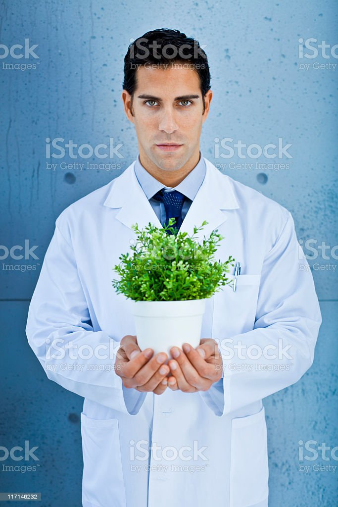 Scientist holding a green plant royalty-free stock photo