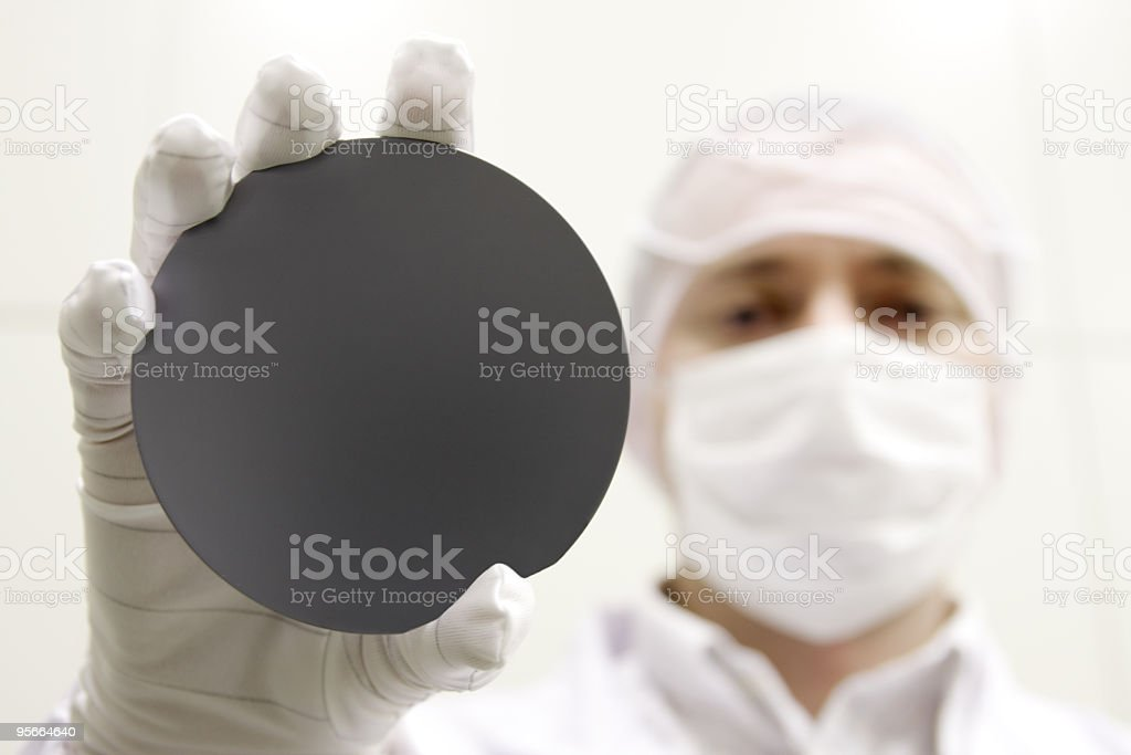 A scientist holding up a black circle to the camera stock photo