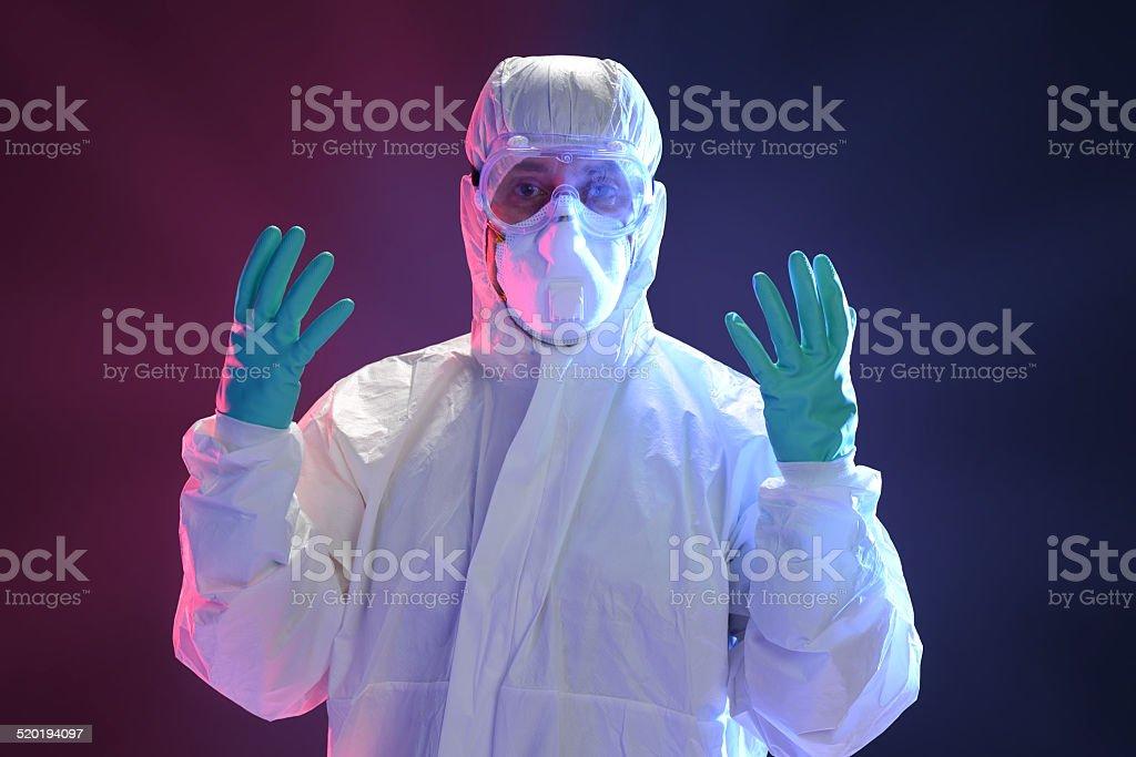 Scientist in full protective hazmat suit stock photo