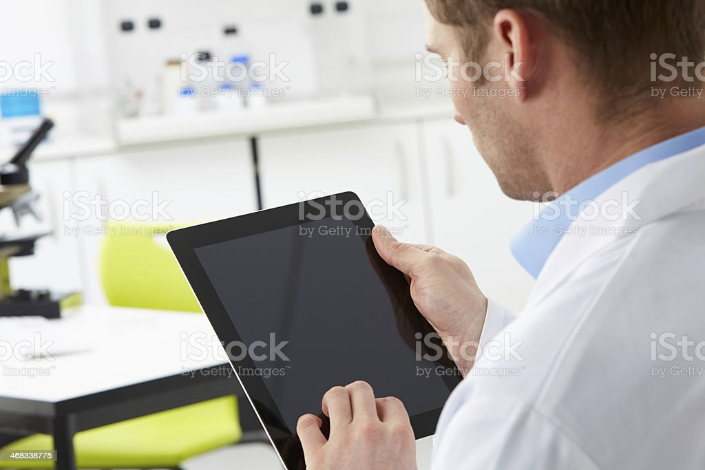 Scientist In Laboratory Using Digital Tablet royalty-free stock photo