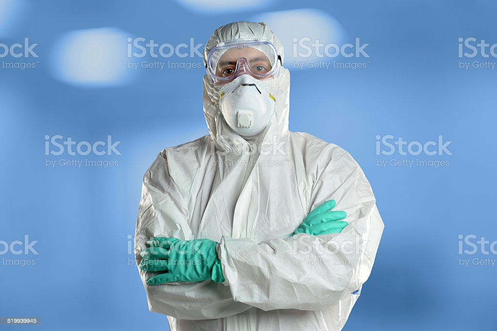 Scientist in Protective Hazmat suit in Laboratory stock photo