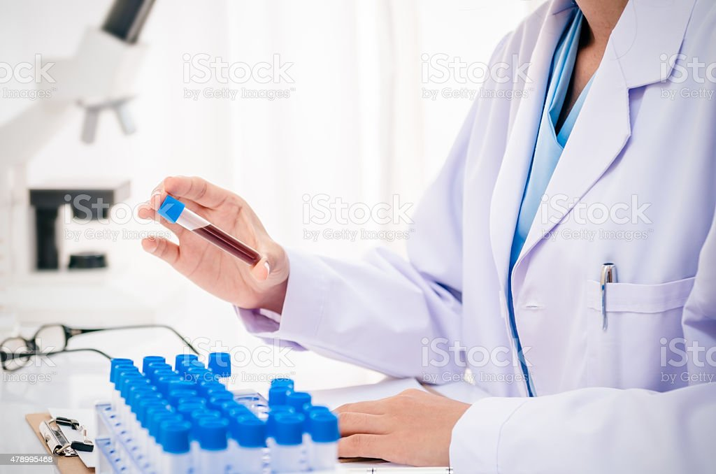 scientist in research lab stock photo