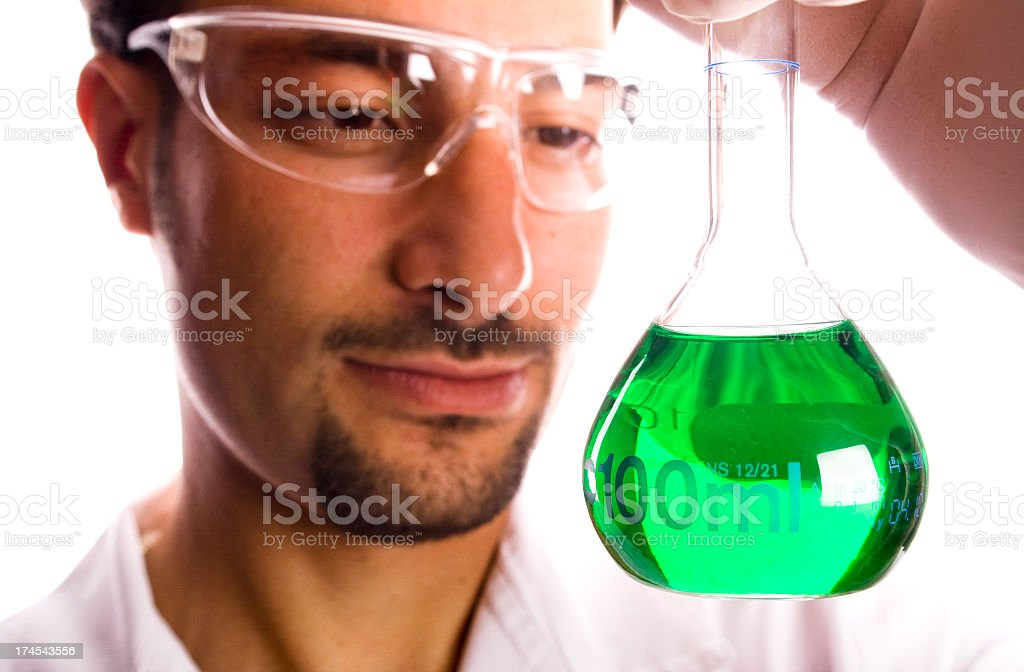Scientist looking at Green Liquid royalty-free stock photo