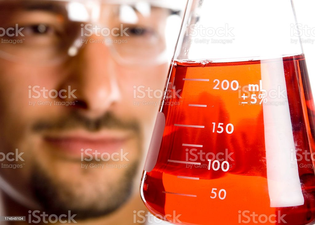 Scientist looking at Red Liquid royalty-free stock photo