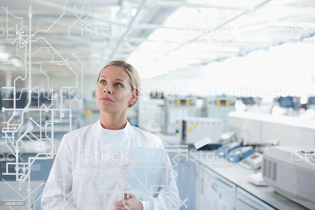 Scientist looking touch screen in lab stock photo