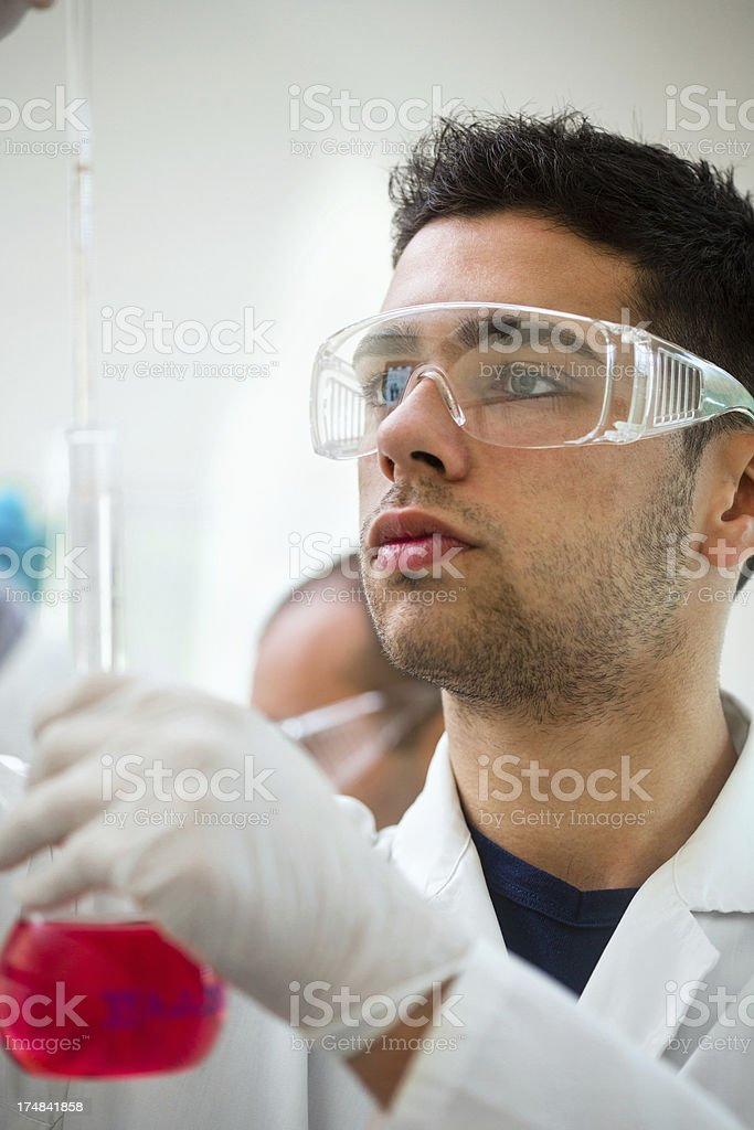 Scientist pipetting liquid sample royalty-free stock photo