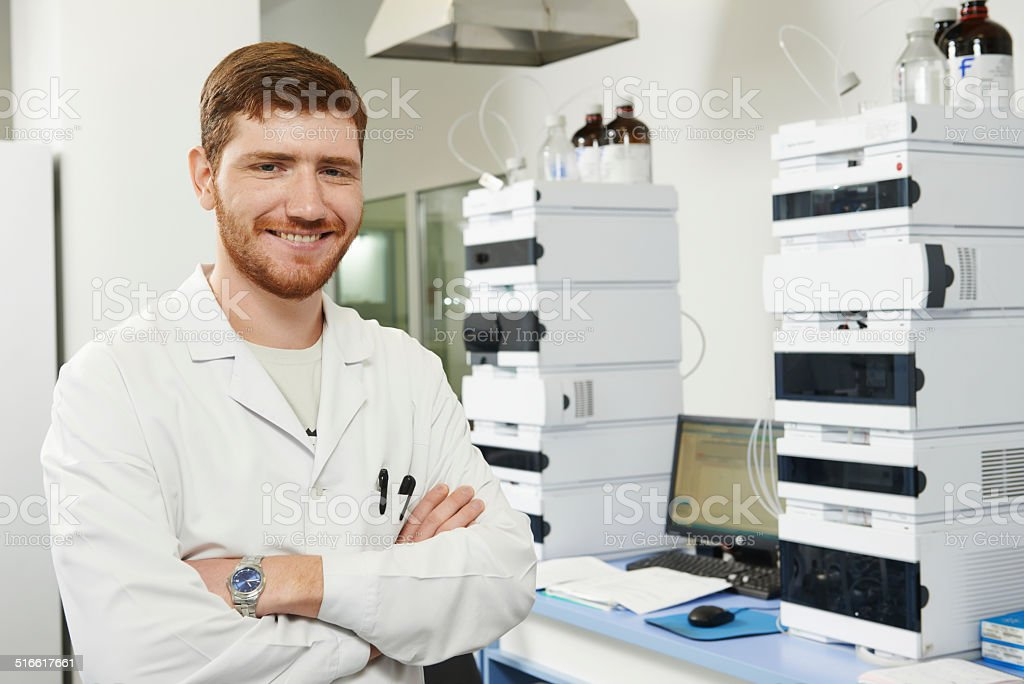 Scientist researcher man in laboratory stock photo