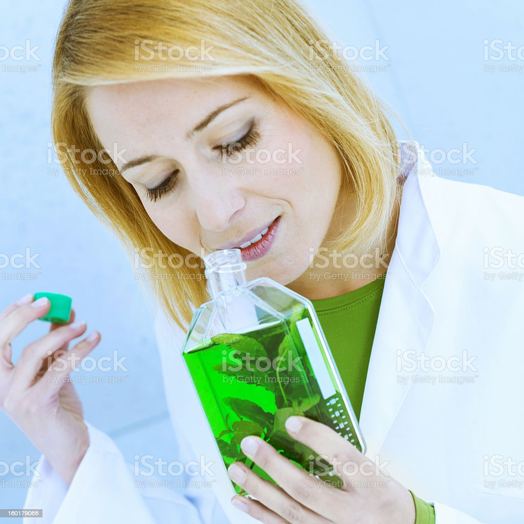 Scientist smelling liquid royalty-free stock photo
