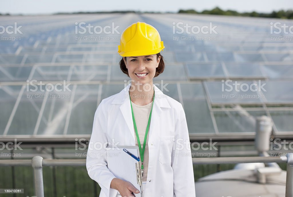 Scientist standing on roof of building royalty-free stock photo