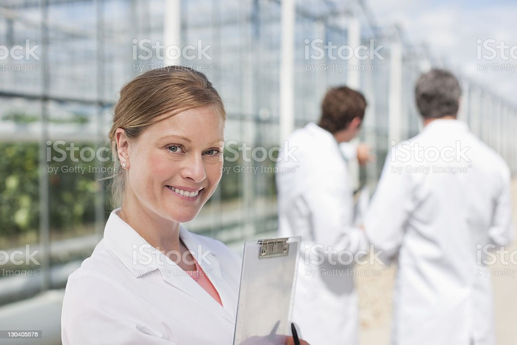 Scientist standing outside greenhouses royalty-free stock photo