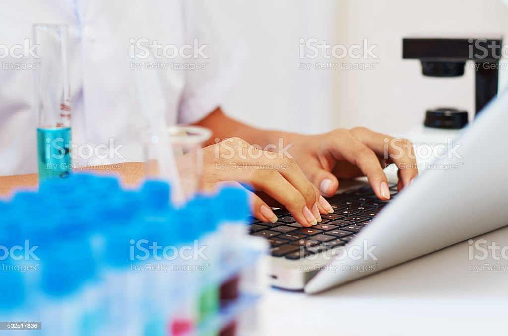 scientist typing stock photo