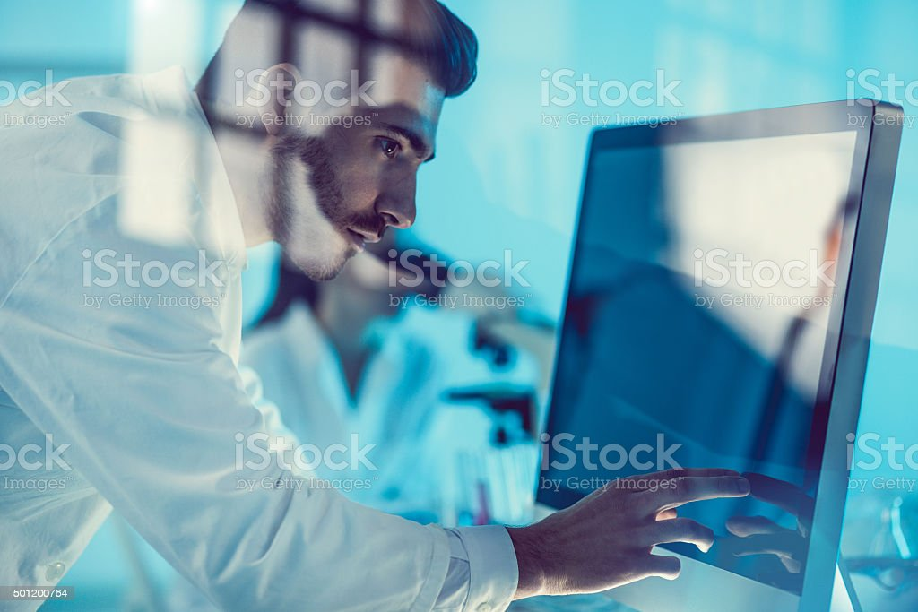 Scientist uses modern technology for its research stock photo